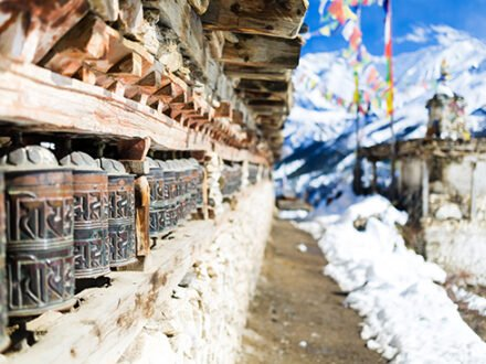 Prayer wheels in high Himalaya Mountains, Nepal village. Annapurna Two range region in Nepal, located at Annapurna Circuit Trekking Hiking Trail
